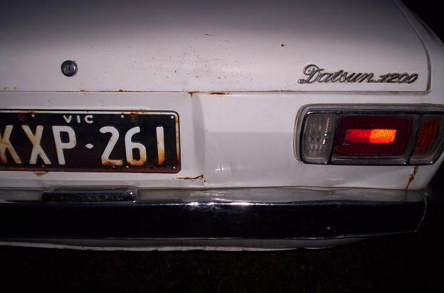 wrecking auto sedan   rear ding