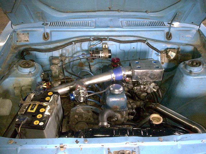 engine bay with 90% of turbo setup