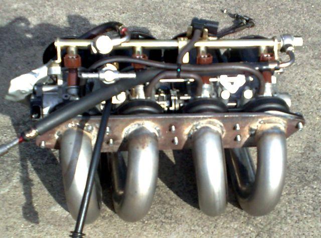 Quad throttle manifold 10