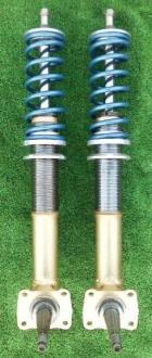 Coil-over-spring struts